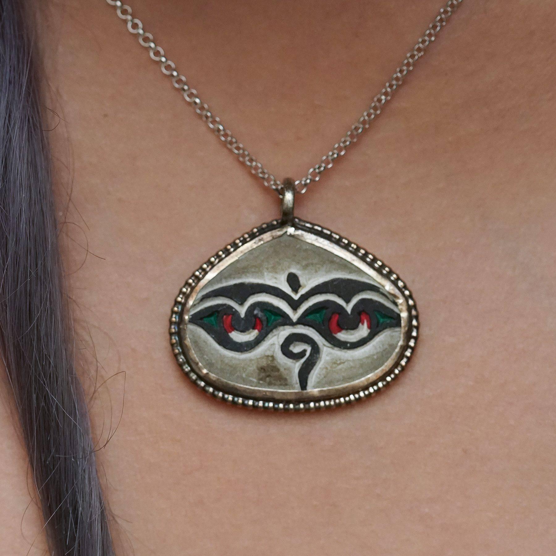Mani stone pendants