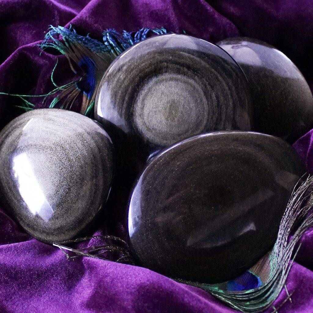 dual silver and golden sheen obsidian palm stones