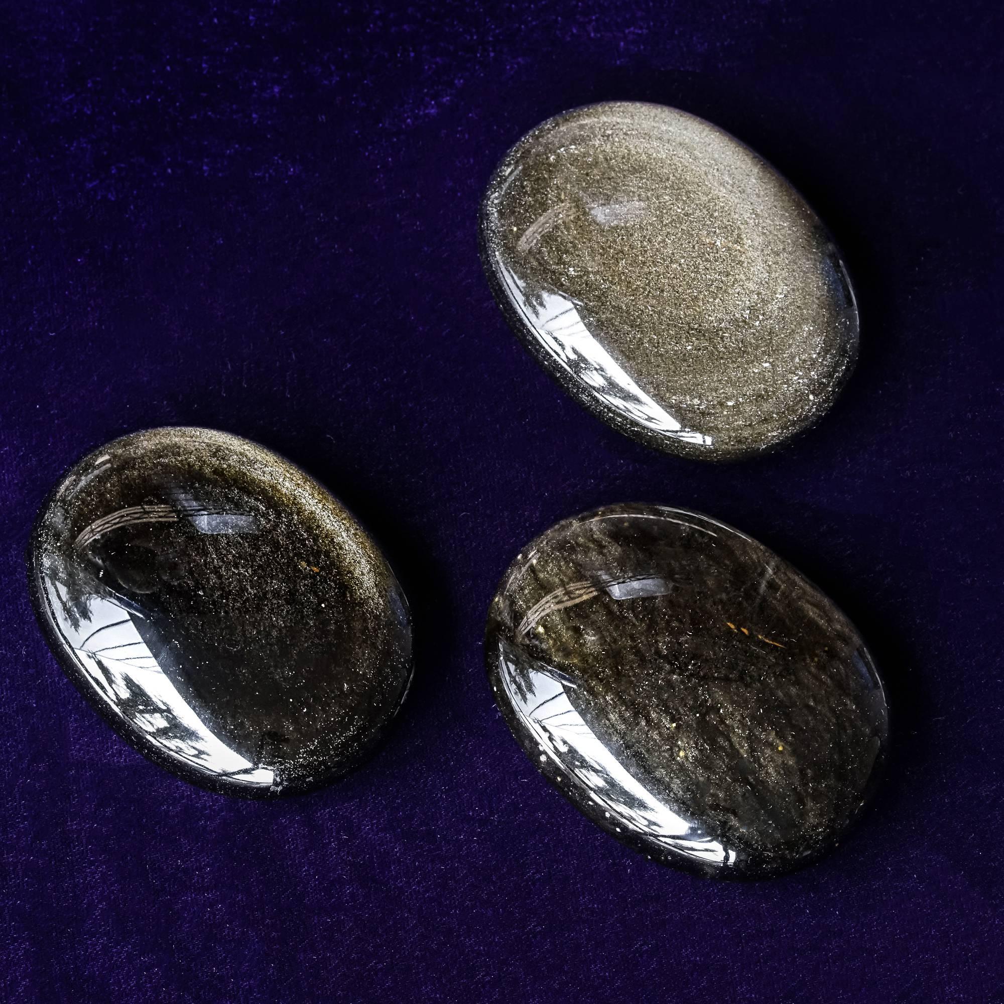 golden sheen obsidian palm stone