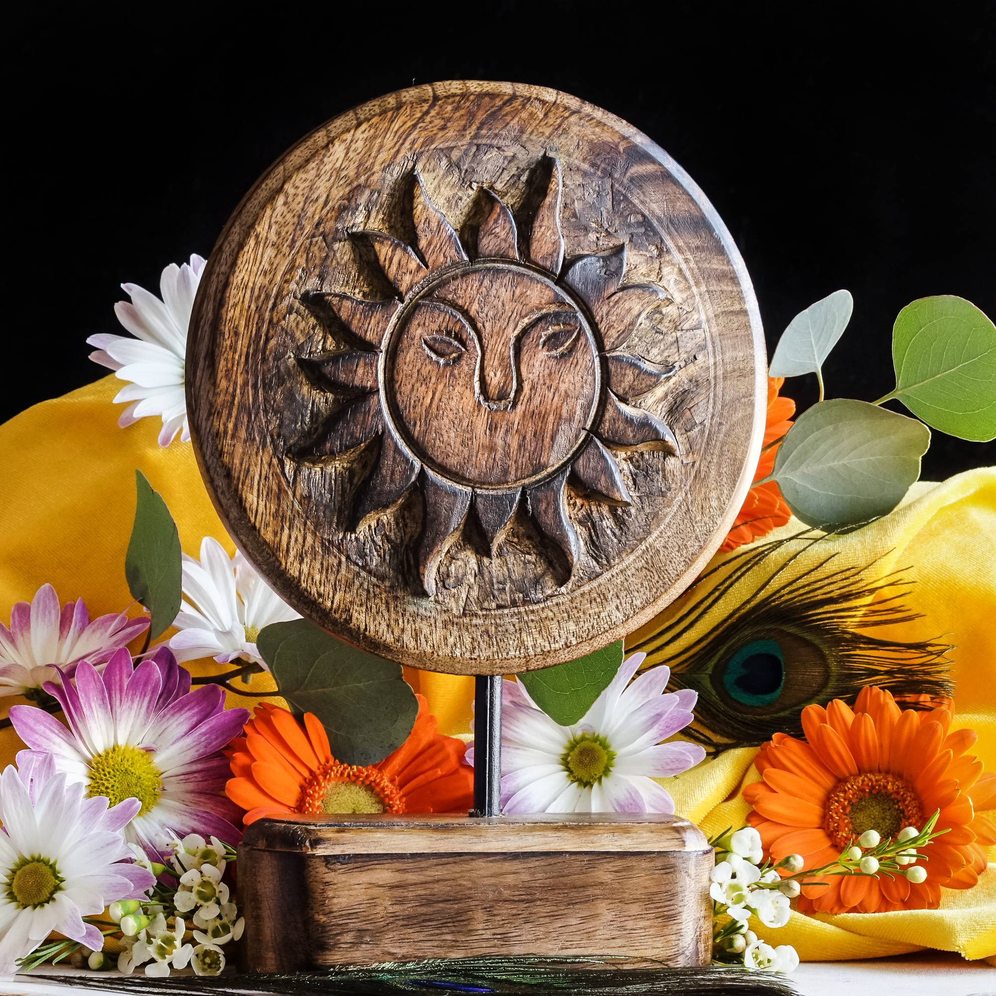 carved wooden sun