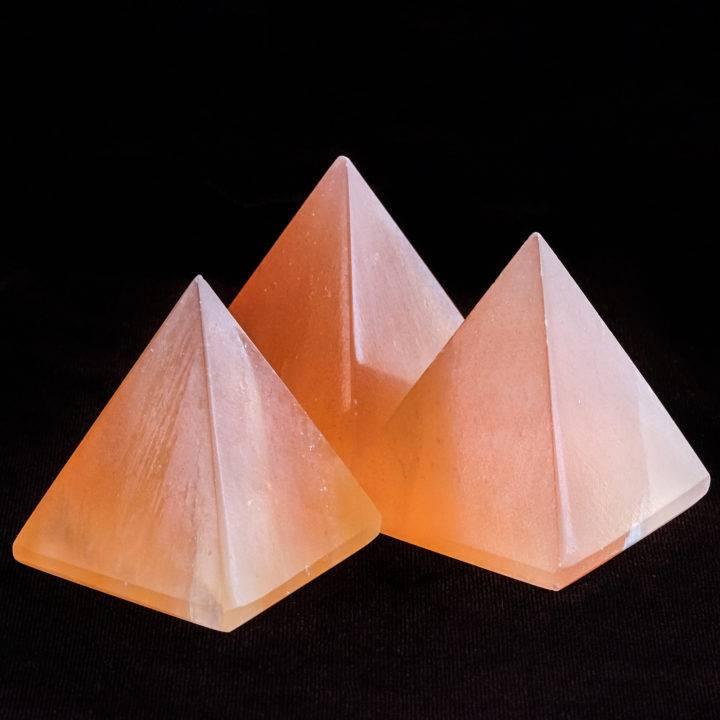 orange selenite pyramid carvings