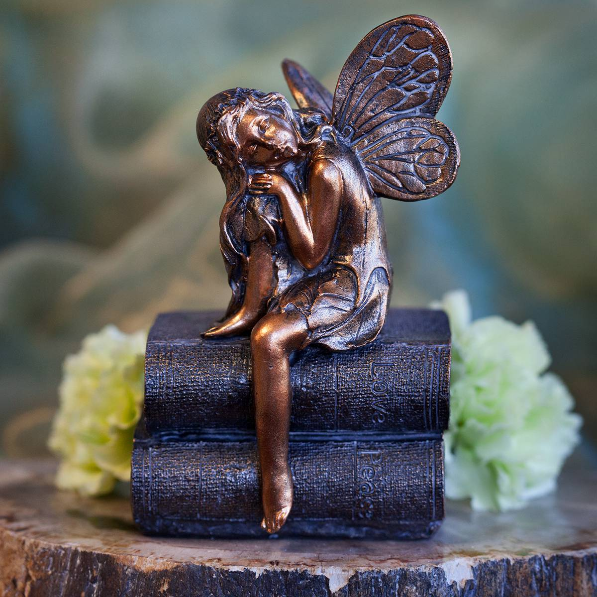 fairy napping on book figurines
