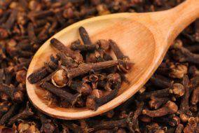 bigstock-Cloves-spice-And-Wooden-Spoo-45136120
